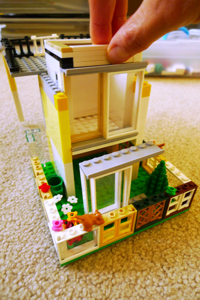 lego elevator between a garden and a balcony