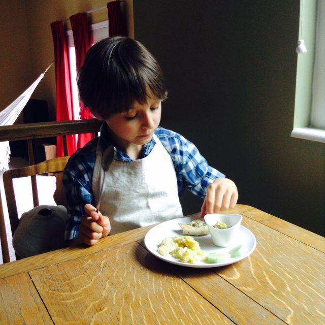 Tasting his appetizer.