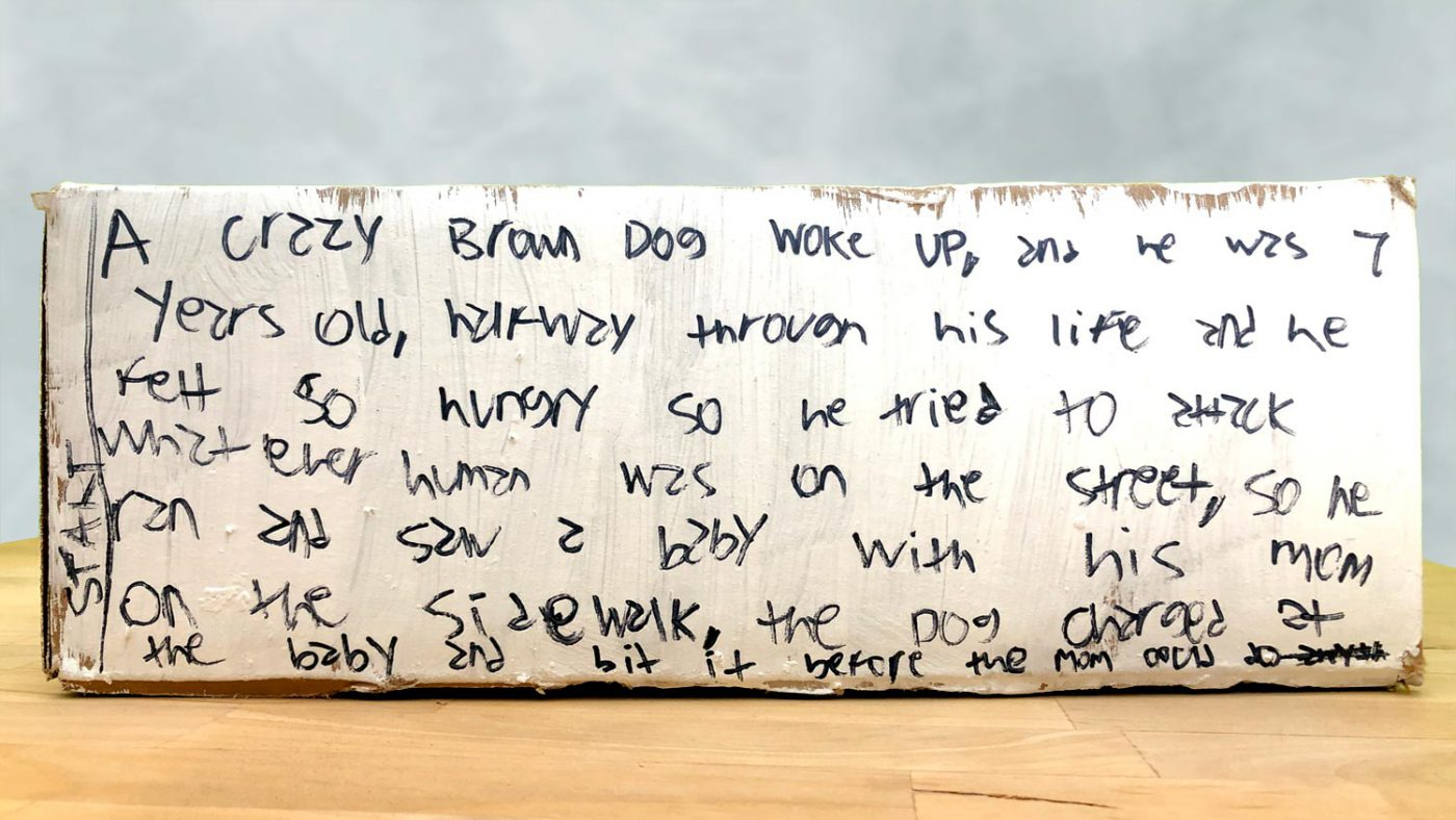 Part 1 of the story written on a side of the box