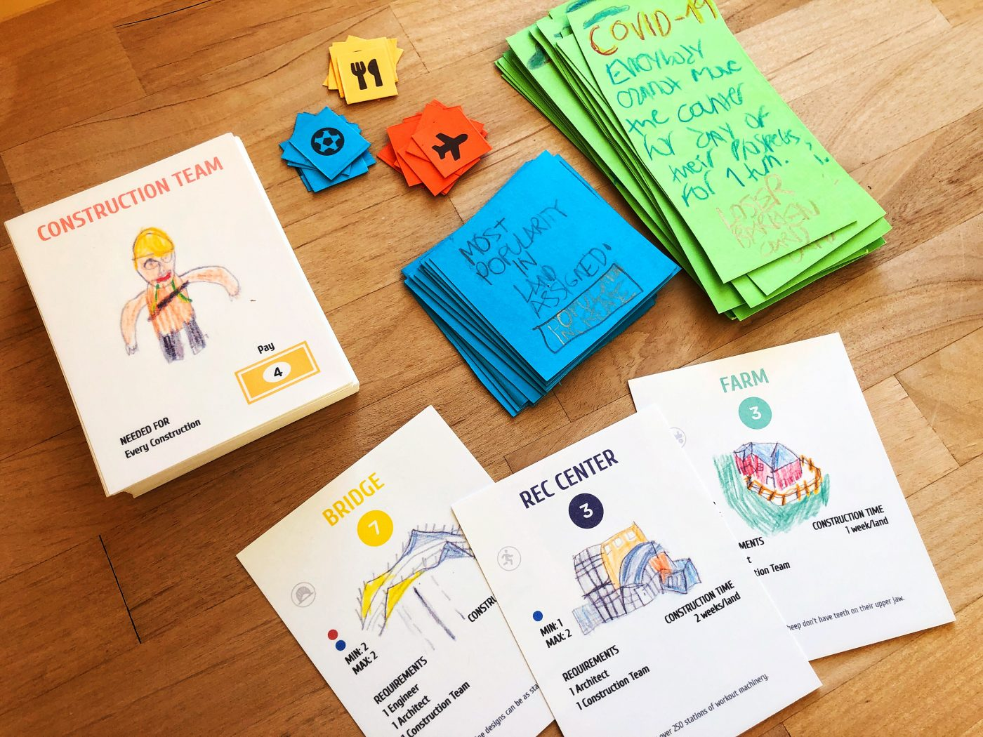 Some of the materials: Prospect cards, Worker cards, Barren cards, Bonus cards, and building tokens