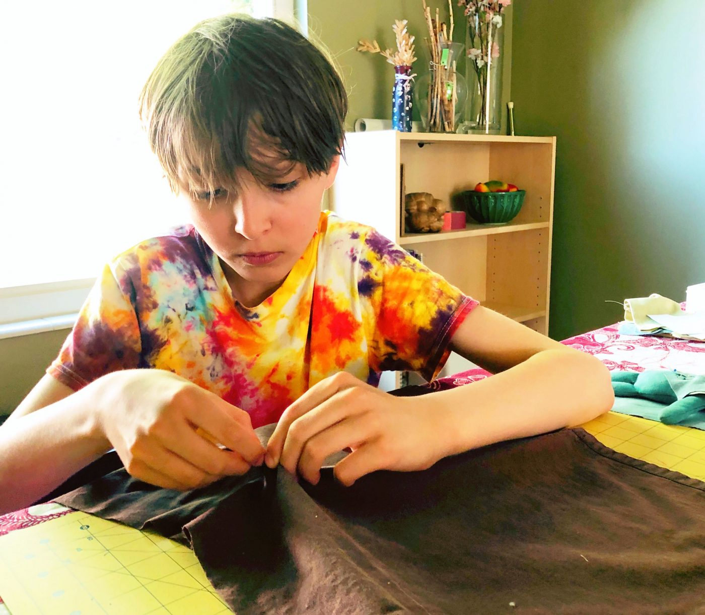 Sewing Rhegan's homeless cape